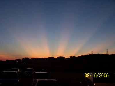 This is a non enhanced photo of the sunset on 09-16-2006 at Three Sisters Park near Peoria,IL. This sunset followed on the day in which Codetalker Thomas Begay spoke to the crowd about his life as a Codetalker.