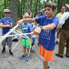 "DCR celebrate Henry Thoreau's 200th birthday with ""Henry's Watermelon Party"" at Walden Pond State Reservation.  Ethan Funk, 13, of Acton, plays The Game of Graces, throwing the ring by moving the sticks apart. The 19th Century game was supposed to make girls graceful. (SUN/Julia Malakie)"