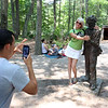 "DCR celebrate Henry Thoreau's 200th birthday with ""Henry's Watermelon Party"" at Walden Pond State Reservation. Jennifer Lewis of Little Rock, Arkansas, poses for a photo with the Thoreau statue. She said ""I had no idea this was his birthday. He was my favorite writer"" when she studied literature in college. Her son Jori Aldridge of North Andover, left, is a student at Mass College of Pharmaceutical Health Sciences. (SUN/Julia Malakie)"