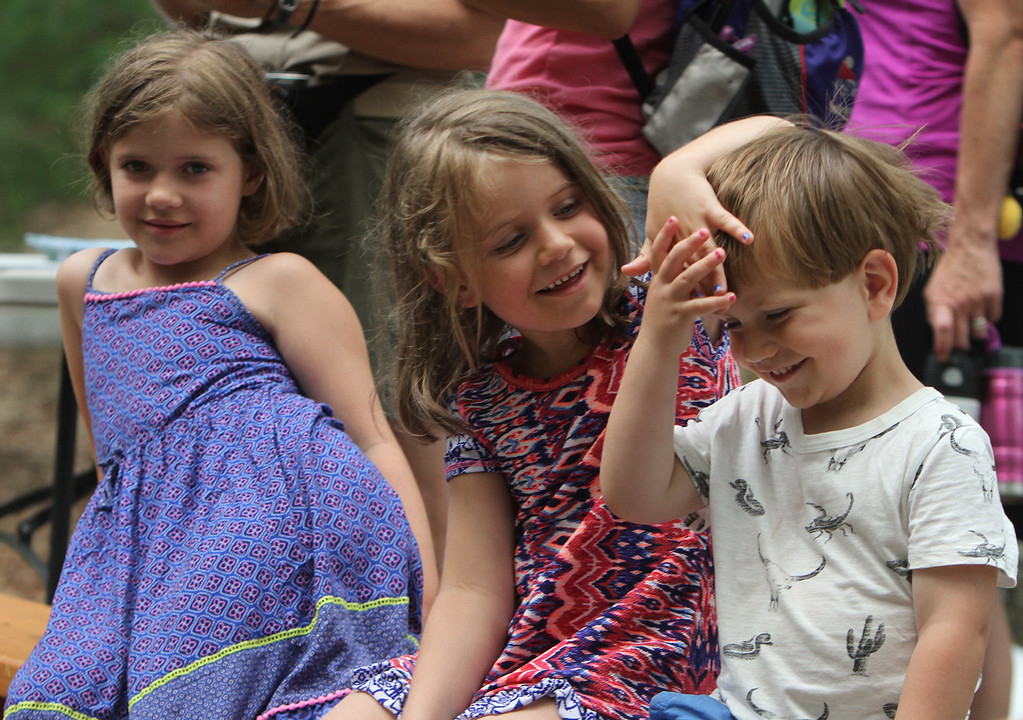 ". DCR celebrate Henry Thoreau\'s 200th birthday with ""Henry\'s Watermelon Party\"" at Walden Pond State Reservation. From left, siblings Emma. 7, Sofia, 5, and Teo Triopolini, 3, of Natick. They\'re from Switzerland but their family is in the US for a couple of years. (SUN/Julia Malakie)"