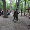 "DCR celebrate Henry Thoreau's 200th birthday with ""Henry's Watermelon Party"" as historian Richard Smith of Acton portrays Thoreau at the replica house at Walden Pond State Reservation.  Gerry Katzban of Putnam Valley, N.Y., takes a picture of the Thoreau statue, with Smith in the background. Katzban had not known about the birthday, but was in the area dropping off his son at an MIT summer program. He said Thoreau ""is one of my heroes. I've been meaning to come here for 30 years and this is the day I came. (SUN/Julia Malakie)"