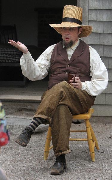 """DCR celebrate Henry Thoreau's 200th birthday with """"Henry's Watermelon Party"""" as historian Richard Smith of Acton portrays Thoreau at the replica house at Walden Pond State Reservation.  (SUN/Julia Malakie)"""