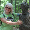"DCR celebrate Henry Thoreau's 200th birthday with ""Henry's Watermelon Party"" at Walden Pond State Reservation. Jennifer Lewis of Little Rock, Arkansas, poses for a photo with the Thoreau statue. She said ""I had no idea this was his birthday. He was my favorite writer"" when she studied literature in college.(SUN/Julia Malakie)"
