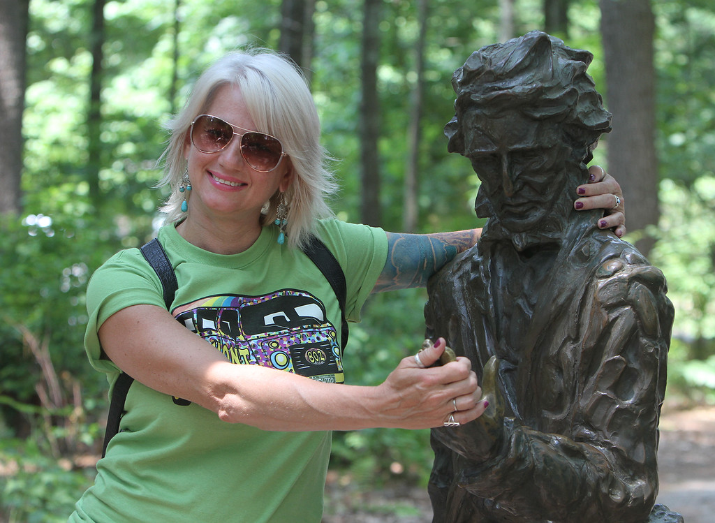 ". DCR celebrate Henry Thoreau\'s 200th birthday with ""Henry\'s Watermelon Party\"" at Walden Pond State Reservation. Jennifer Lewis of Little Rock, Arkansas, poses for a photo with the Thoreau statue. She said \""I had no idea this was his birthday. He was my favorite writer\"" when she studied literature in college.(SUN/Julia Malakie)"