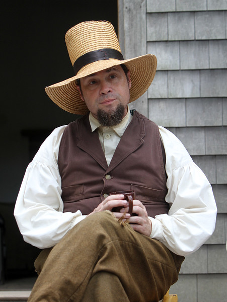 "DCR celebrate Henry Thoreau's 200th birthday with ""Henry's Watermelon Party"" as historian Richard Smith of Acton portrays Thoreau at the replica house at Walden Pond State Reservation.  (SUN/Julia Malakie)"