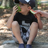"DCR celebrate Henry Thoreau's 200th birthday with ""Henry's Watermelon Party"" at Walden Pond State Reservation. Dawson Fischer, 4, of Concord, eats watermelon slices, which were served because Thoreau was known for growing the sweetest watermelons at his family's home in town, and would share with others. The watermelons were donated by Donelan's Market in Lincoln and Crosby's Market in Concord. (SUN/Julia Malakie)"