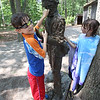 "DCR celebrate Henry Thoreau's 200th birthday with ""Henry's Watermelon Party"" at Walden Pond State Reservation.  Fraternal twins Elden, left, and Arden White, 8, of Lynn, check out the Thoreau statue. They'd come to swim in Walden Pond. (SUN/Julia Malakie)"