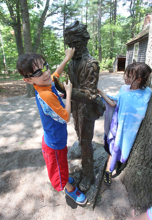 ". DCR celebrate Henry Thoreau\'s 200th birthday with ""Henry\'s Watermelon Party\"" at Walden Pond State Reservation.  Fraternal twins Elden, left, and Arden White, 8, of Lynn, check out the Thoreau statue. They\'d come to swim in Walden Pond. (SUN/Julia Malakie)"