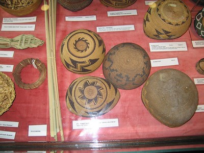 Tongva basketry exhibit: basket hats, Cooper Regional History Museum, Upland, 2 Jul 2005.