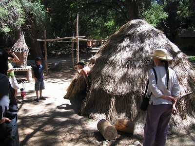 "Typical Tongva dwelling--much reduced scale.  Original dwellings were approx. 35' in diameter.  Tongva Village reconstruction, 2 Jul 2005. ""Enter backwards and go clockwise."""
