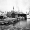 Photo courtesy of the Traverse Area Historical Society<br /> Steamships Puritan and Chequamegon at the Traverse City passenger dock. The West Bay shoreline in Traverse City was a busy place in the latter part of the 1800s and early 1900s when Thomas Bates owned the Grand Traverse Herald. This 1908 photo was taken by Traverse City photographer Orson W. Peck.