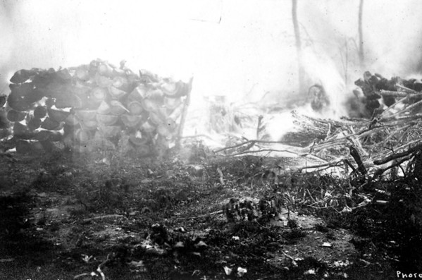 "Courtesy of Traverse Area Historical Society<br /> One of the frequent fires of the early 20th century burns piled wood and slash in the Grand Traverse region. The only identification on this photo was ""Beebe,"" the name of an area photographer."