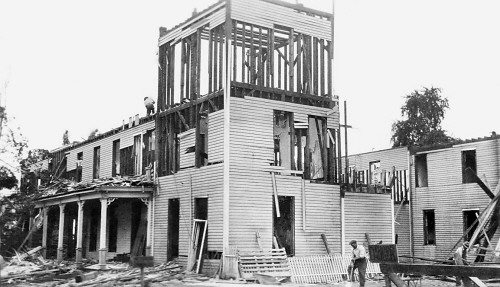 Courtesy of Traverse Area Historical Society<br /> Workers dismantle the old Park Place Hotel, once known as the Campbell House, on Sept. 4, 1929, about eight weeks  before the  stock market crash.  The new nine-story, brick Park Place Hotel opened a year later.
