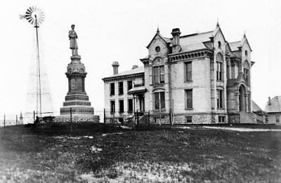 Photo courtesy of Traverse Area Historical Society<br /> The Civil War monument stands watch by the old Grand Traverse sheriff's residence and jail. A gift from local citizens to Civil War veterans, the monument was dedicated on Memorial Day, May 30, 1890, before a crowd of 3,000 to 4,000 people, including 150 veterans and sons. It was moved to the new courthouse lawn about 1900 after the building was completed.