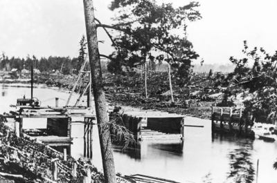 Photo courtesy of Traverse Area Historical Society<br /> Building the Hannah & Lay flour mill dam on the Boardman River just east of Union Street in 1869.