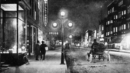 Photo courtesy of Traverse Area Historical Society<br /> Front Street at night in Traverse City about 1900.