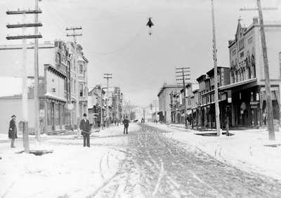 Photo courtesy of Traverse Area Historical Society<br /> Snow muddies Front Street in early Traverse City. This picture looks west from Cass Street.