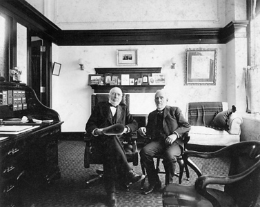 Photo courtesy Traverse Area Historical Society<br /> Perry Hannah and A. Tracy Lay in their Traverse City office in 1903.