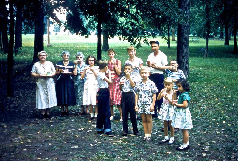 1955:  Sunday School Picnic at Granite City Park:  (L to R):  Lucille Auwarter, Rachel Frangen, Mayme Taylor, Carol Gard, Jim Adams, Jane Gerstenecker, Margie Gerstenecker,  ------, Gary Cline, Oliver Churchal, Dee Adams, Jack Llewellyn, Bonnie Caruso.<br /> (Photo by Millie C. Shaffer)