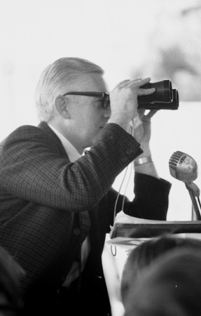Master of Ceremonies Lew Wendell (?) used binoculars to read the board before announcing the results over the PA system.