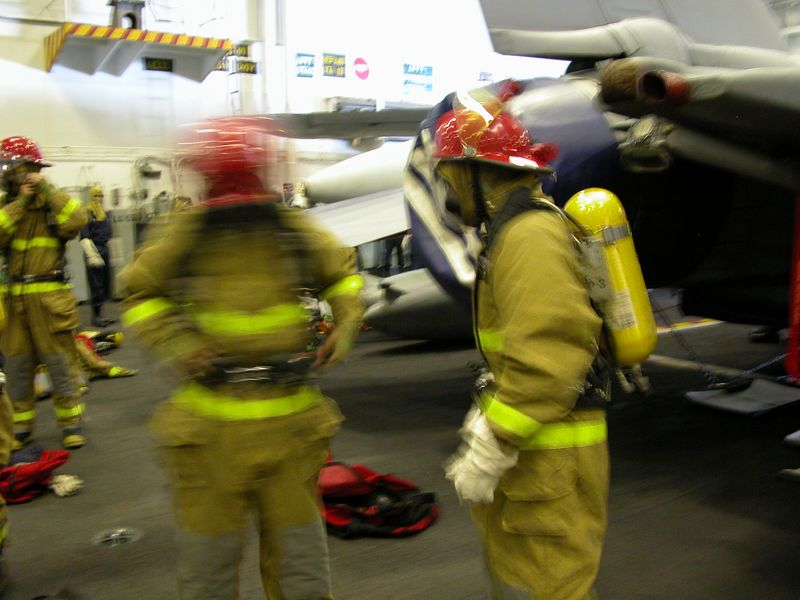 Crew getting ready for General Quarters drill.  Simulated attack on the ship.