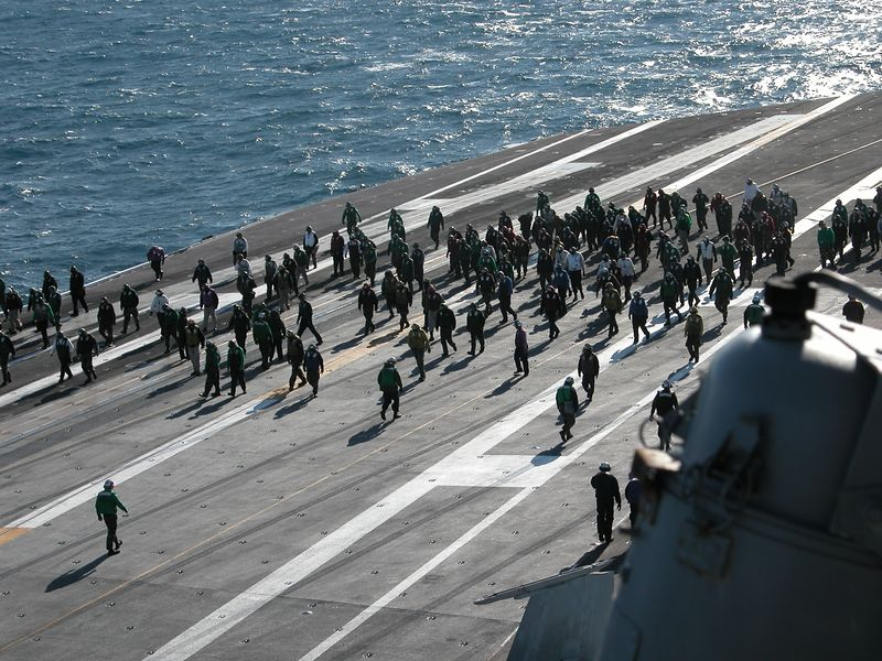 Emergency walkdown.  A small item fell off a plane that just landed.  Since any small object on the Flight Deck could be sucked into a jet engine causing severe damage, the whole flight operations crew joins in a search for the missing item.