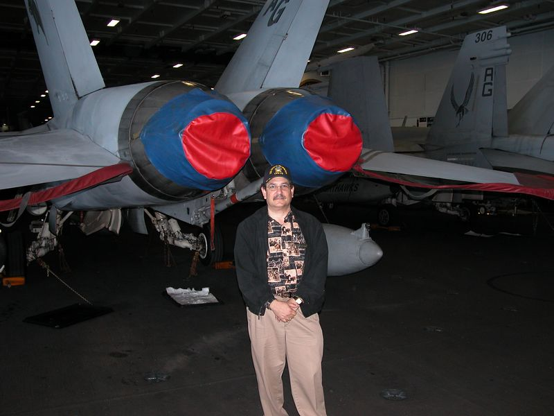 No those aren't boobs.  They are covers for the tail end of a F-18 Hornet.