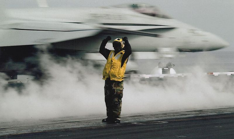 F18 being launched off the aircraft carrier.