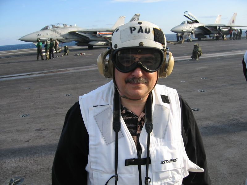 "This is what we had to wear on the Flight Deck.  The ears are  sound  muffling.  The vest is white for ""safety"" and will automaticaly inflate when exposed to seawater."