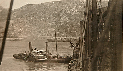 USS Jason (Collier # 12, later AC-12 and AV-2), 1913-1936  Original Notes On the Back of Picture: A tug wraping Jason to a dock at Gib (Gibraltar)