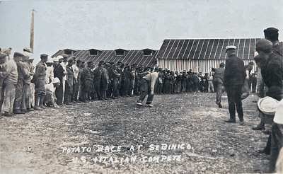 WWI U.S. and Italians play Potato game at Sebenico.  Original Comments on the card: Promoting a friendly feeling between U.S. navy and Italian navy, very badly needed at the time.