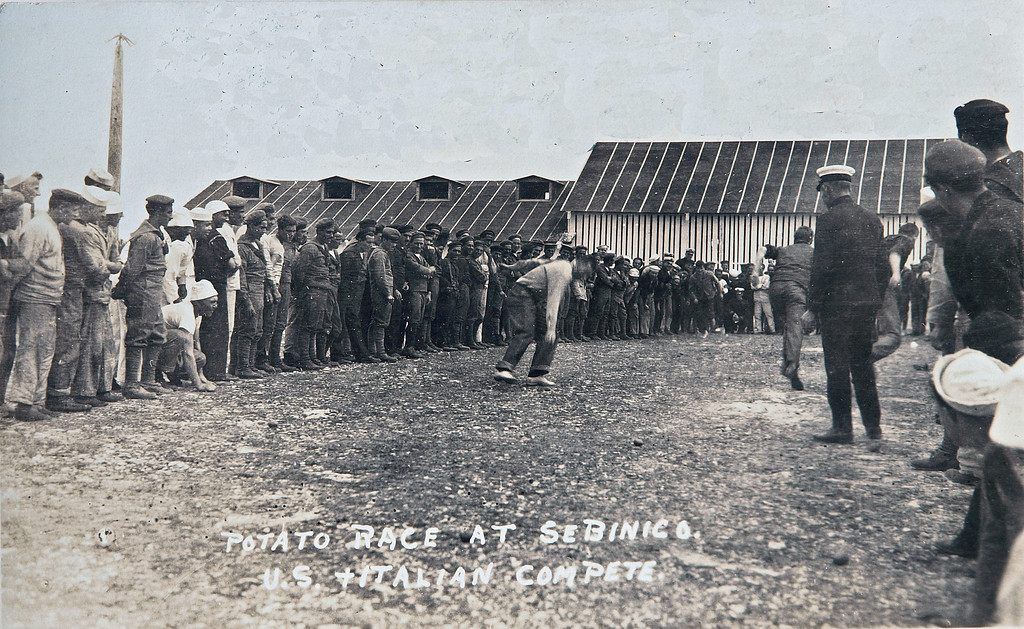 WWI U.S. and Italians play Potato game at Sebenico.<br /> <br /> Original Comments on the card: Promoting a friendly feeling between U.S. navy and Italian navy, very badly needed at the time.