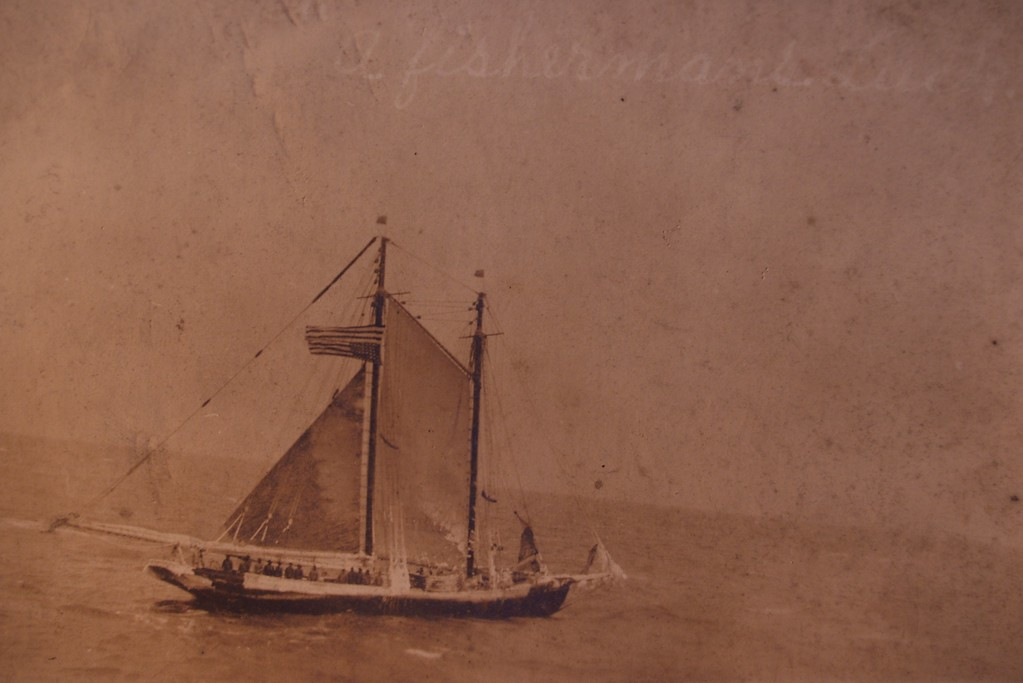 USS Jason (Collier # 12, later AC-12 and AV-2), 1913-1936   <br /> Original Title: Schooner Hesperus of Gloucester    <br /> Original Notes On the back if Picture: This is the picture of the fishing boat we rescued somewhere on the Atlantic. Note the ice on the boat ?word? the flag turned upside down which means in distress. She was caught in a storm and loss her rudder ship must have been adrift for two days before we sighted her and towed her in.  (Feb 6, 1918)