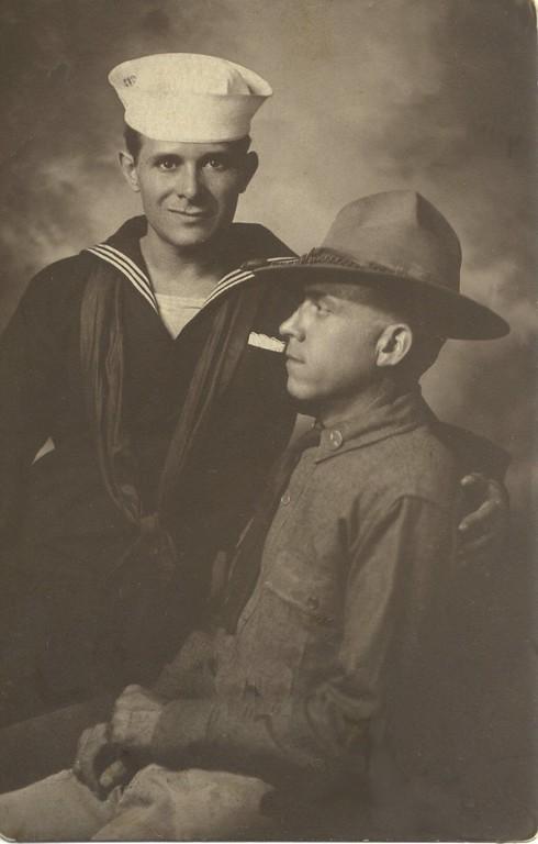 Gabe Raggio Sr (standing) was a crewman on the USS Jason.