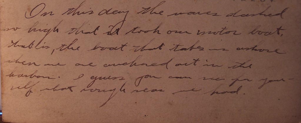 A sample of the writing on the back of the pictures. It states: On this day the waves dashed so high it took our motor boat. That is, the boat that takes us ashore when we are anchored out in the harbour. I guess you can see for yourself what rough seas we had.