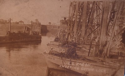 Jason (AC-12) entering Gatun Lock, Panama Canal, with a deck load of seaplane barges, during the early 1920s. The barges are (from the front) YV-21, YV-23 and YV-24. Same picture in the Navy archives below: http://www.navsource.org/archives/09/09021212.jpg http://www.navsource.org/archives/09/0212.htm