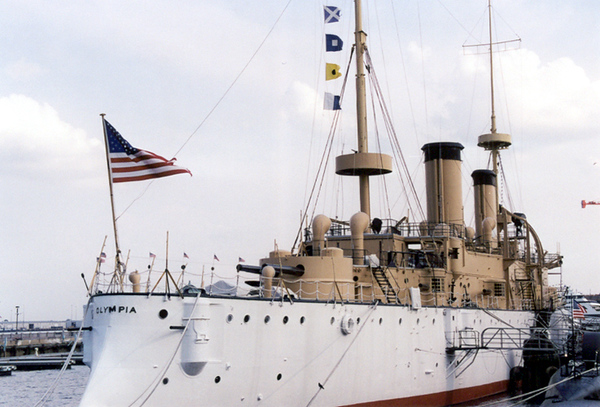 Photo shows the USS Olympia, which served as flagship of the Asiatic Squadron in the Spanish-American War. Without a major refurbishment to its aging steel skin, the Olympia either will sink at its moorings on the Delaware River, be sold for scrap, or be scuttled for an artificial reef 90 miles south.
