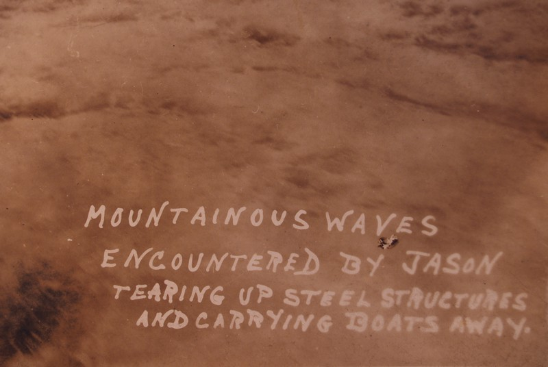 Original Title: MOUNTAINOUS WAVES ENCOUNTERED BY JASON TEARING UP STEEL STRUCTURES AND CARRYING BOATS AWAY. <br /> Original Notes On the Back of Picture: On this day the waves dashed so high it took our motor boat. That is, the boat that takes us ashore when we are anchored out in the harbour. I guess you can see for yourself what rough seas we had.