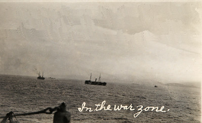 USS Jason (Collier # 12, later AC-12 and AV-2), 1913-1936  Original Comments on the card state: In the war zone off the coast of Scotland in May or April 1918. Note the British Destroyers scouting for the ship. See the three ships barely seen in the picture past the two ships clearly seen in the foreground.