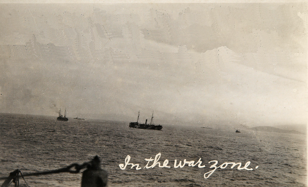 USS Jason (Collier # 12, later AC-12 and AV-2), 1913-1936<br /> <br /> Original Comments on the card state: In the war zone off the coast of Scotland in May or April 1918. Note the British Destroyers scouting for the ship. See the three ships barely seen in the picture past the two ships clearly seen in the foreground.