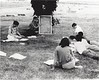 CSC Upward Bound group studying math on grass south of Kent, 1967. Instructor Bob Brown writing on chalk board. (Courtesy photo)
