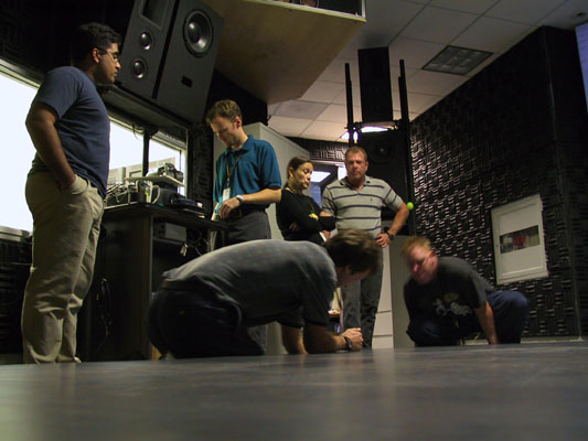 The infrasonic floor was created by Jacki Morie to allow the creation of an emotional score for VR experiences. The score was not heard but felt viscerally by the body during the experience. c. 2005