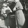 10. Nell standing with a friend of whom she was not fond of.