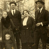 2. From left, Nellie Wells Barrett, her brother Walter Frank Wells, Walter's wife Lorene, and her brother Sam. Cropped from the larger Wells photo, from about 1923. If from of Nellie is her youngest child, John Clinton Barrett, born 1920. <br /> <br /> <br /> I see on Ancestry.com that Hiram Sam Wells married Lola May Hardin on Jan 25, 1924 in Monette.  I also have a note showing Sam married Lola Fay Goss on Feb 28, 1924. So, I'm not sure which is correct.  Sam had two children: (1.) Billie Lou, born Nov 3, 1924 and still living in Buena Park, CA as of 2013; and (2.) Gene Hardin, a half brother to Billie Lou. Gene was killed on the Arizona on December 7, 1941.