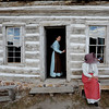 "Evan Claire Williams, left, and Shirley Hollingsworth, check out the rain in the old store.<br /> Visitors at Walker Ranch Homestead saw what summer was like on a ranch in the 1800s in Boulder County. For more photos and a video of Walker Ranch, go to  <a href=""http://www.dailycamera.com"">http://www.dailycamera.com</a>.<br /> Cliff Grassmick  / July 29, 2012"