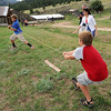 "Isaac Ward, left, and brother, Joe, try out one of the games of the time period.<br /> Visitors at Walker Ranch Homestead saw what summer was like on a ranch in the 1800s in Boulder County. For more photos and a video of Walker Ranch, go to  <a href=""http://www.dailycamera.com"">http://www.dailycamera.com</a>.<br /> Cliff Grassmick  / July 29, 2012"