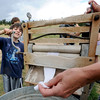 "Michael Naor, 9, learns the early ways of washing socks during a demonstration at Walker Ranch on Sunday.<br /> Visitors at Walker Ranch Homestead saw what summer was like on a ranch in the 1800s in Boulder County. For more photos and a video of Walker Ranch, go to  <a href=""http://www.dailycamera.com"">http://www.dailycamera.com</a>.<br /> Cliff Grassmick  / July 29, 2012"