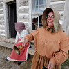 "Sheryl Kippen rings the school bell to get a tour started at Walker Ranch on Sunday.<br /> Visitors at Walker Ranch Homestead saw what summer was like on a ranch in the 1800s in Boulder County. For more photos and a video of Walker Ranch, go to  <a href=""http://www.dailycamera.com"">http://www.dailycamera.com</a>.<br /> Cliff Grassmick  / July 29, 2012"