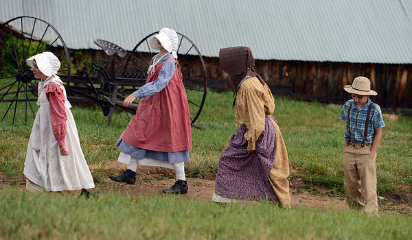 "Children of the homestead period roam the ranch during a light rain.<br /> Visitors at Walker Ranch Homestead saw what summer was like on a ranch in the 1800s in Boulder County. For more photos and a video of Walker Ranch, go to  <a href=""http://www.dailycamera.com"">http://www.dailycamera.com</a>.<br /> Cliff Grassmick  / July 29, 2012"