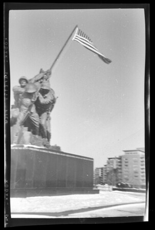 False flag? The marines at the Iwo Jima Memorial seem to be raising a 48 star flag. Should have been 49 stars as Alaska joined the Union weeks before the photo was made. The 50th state, Hawaii, officialy joined later that year. Have you ever seen a 49 star U.S. flag?